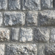 Wall by stones - Stock Photo