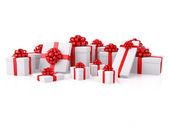 Group of white gift boxes with red bows — Stock Photo