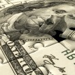 Stock Photo: Jigsaw puzzle US dollar