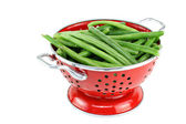 Washed string beans in red colander. — Stock Photo