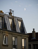 Day half-moon over the parisian roofs — Stock Photo