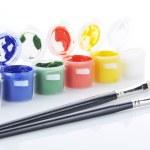 Gouache paint and brush — Stock Photo