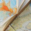 Atlas book on  map — Stock Photo