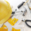Stock Photo: Yellow hardhat on drawings