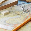 Map and glasses — Stock Photo