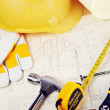 Yellow hardhat on drawings — Stock Photo