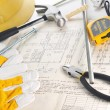 Yellow hardhat on drawings - Stockfoto