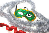 Mask and silvery garland — Stock Photo