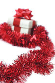 Present wraped by red ribbon — Stock Photo