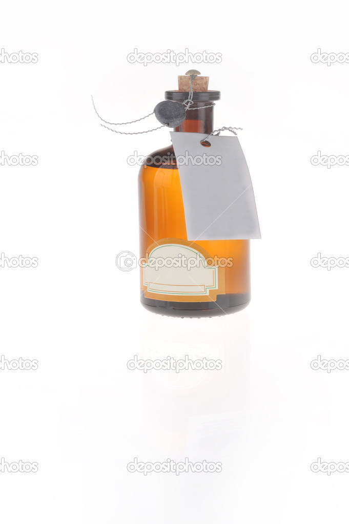 Bottle with  cosmetic mean closed by  stopper isolated on white  Foto de Stock   #2645910