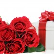 Beautiful red roses and present — Stock Photo
