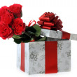 Beautiful red roses and present — Stock Photo #2650261
