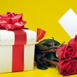 Beautiful red roses and present — Stock Photo #2650381
