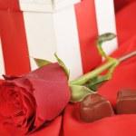 Gift and chocolate — Stock Photo