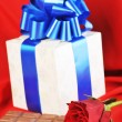 Gift and chocolate — Stock Photo
