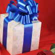 Stock Photo: Rose and gifts in box