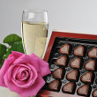 Champagne and pink rose — Stock Photo