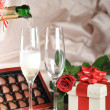 Gift in box and champagne — Stock Photo