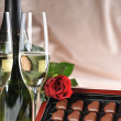 Champagne and red rose — Stock Photo #2653348