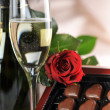 Champagne and red rose — Stock Photo #2653380