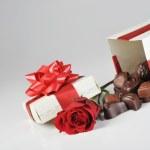 Chocolates and rose — Stock Photo