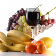 Different fruits and glass of wine — Stock Photo