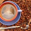 Coffee beans cup with coffee and spoon — Stock Photo
