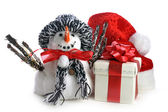 Snowman and giftbox on white — Stock Photo