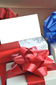 Gift boxes with name card — Stock Photo