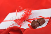 Chocolate and letter — Stock Photo