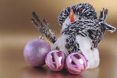 Snowman with christmas stuff — Stock Photo