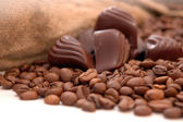 Coffee beans, chocolate and bag — Stock Photo
