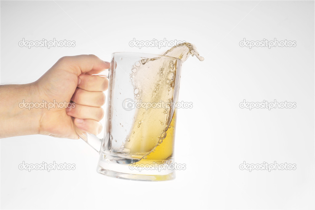 Hand holding beer in glass close up — Stock Photo #2658124