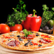 Foto Stock: Tasty pizza on plate