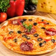 Tasty pizza on plate — ストック写真