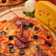 Tasty pizza on plate — Stockfoto