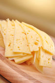 Sliced yellow cheese — Stok fotoğraf