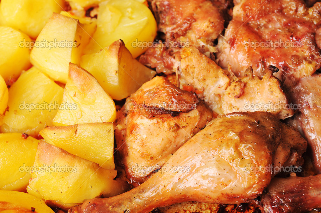 Tasty roast chicken with  potato close up  Stock Photo #2663110