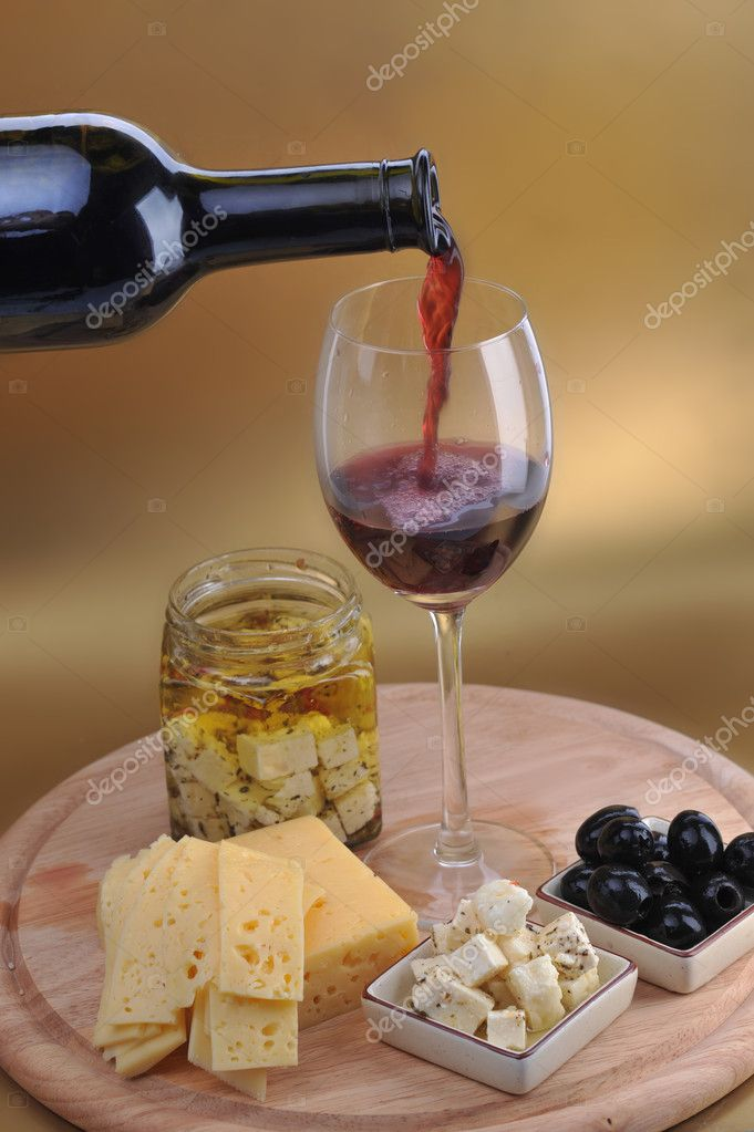 Wine bottle and cheese on gold background — Stock Photo #2663354