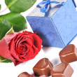 Rose and  gifts in box — Stock Photo