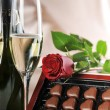 Stock Photo: Champagne and red rose