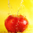 Apple and water splashes — Stock Photo