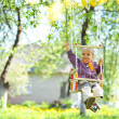 Swinging girl — Stock Photo