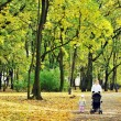 Mother and child walking in park — Stock Photo #2673839