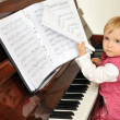 Girl plays piano — Stock Photo