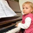 Girl plays piano — Stock Photo #2673942