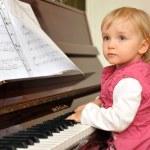 Girl plays piano — Stock Photo #2673942