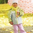 Girl playing in autumn park — Stock Photo #2673949