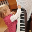 Girl plays piano — Stock Photo #2673951