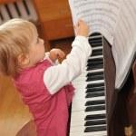 Girl plays piano — Stock Photo #2673951